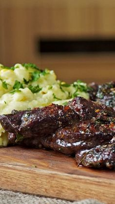 Thinly sliced and packed with flavorful spices, this meat dish is perfectly complemented by a side of mashed corn and potatoes.