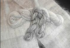 D. Lee Woolee's Rabbitry and Yarns  (just an interesting how to on making yarn from rabbit fur... it's fun to dream of such things)  :)