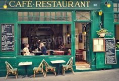 PARIS - JULY 08  Two women sitting on open terrace in typical Parisian cafe  Restaurants ba mural
