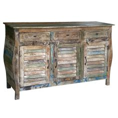 Add a rustic touch to your living room or den with this 3-drawer mango wood sideboard, showcasing louvered door fronts and a weathered multicolor finish.
