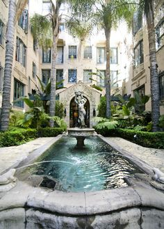 The garden courtyard of the Los Altos Apartments at 4121 Wilshire Blvd, Los Angeles. The apartments were once home When built (in 1925), the Spanish-Colonial Los Altos Apartments began as a co-op and were later used as a luxury apartment and hotel catering to stars like Clara Bow, Bette Davis, Mae West, Douglas Fairbanks, and William Randolph Hearst.