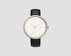 Polished gold watch and a black coloured strap. #Hirigoyen #tellingithowitis