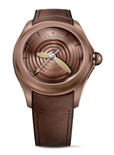 The @corumwatches Bubble Drop, in a brown-PVD-coated case, has a matching brown dial made of brass that features a pattern of furrows and shadows that mimic the surface of moving water.  This watch was designed by Corum and industrial designer Nicolas Le Moigne and is limited to 350 pieces.  For the full story, visit http://www.watchtime.com/wristwatch-industry-news/watches/return-of-the-corum-bubble-watch-three-new-models-debut/ #corum #watchtime #watchnerd