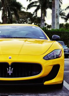 Yellow Maserati Gran Turismo.