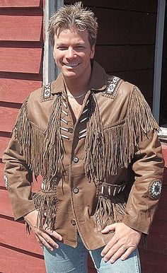"""Brown leather jacket with western fringe and Indian bone beading. Features 8"""" leather fringe, inside chest pocket and quilted lining. #M2633BBFN"""