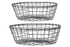 Two lovely metal vintage looking baskets for collecting all kinds of kitchen stuff.