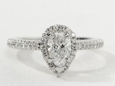Pear shape diamond surrounded by diamond halo.  www.dutchdiamondimports.com 214-742-5707