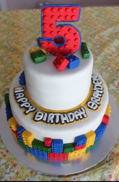 "LEGO Birthday Cake Idea-like bricks around base and ""scattered"" on top."