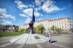 statue in bronze symbolizing czech republic in the small park area near klarov Street ;later becoming manesuv bridge,one of several bridges across the river,prague