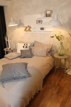 Slaapkamer met leuk verfeffect op de muur