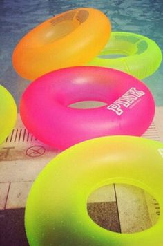 Neon pool floats. These would be perfect for floating around in all summer...with a #PinnacleVodka drink in hand :)