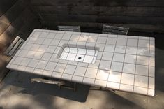 A table for cold drinks. #dtile #tiles #table #cold #drinks #chilled #garden #summer