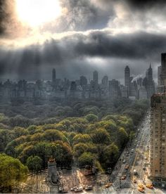 NYC. Central Park South  and Central Park taken from Columbus Circle  under a heavenly, mystical  light...