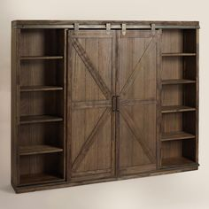 A substantial storage solution with adjustable and removable shelving, our bookshelf is crafted of distressed solid wood with rustic metal accents that give it the look of an old barn door. Barn Door Bookcase, Barn Door Cabinet, Bookcase Closet, Barn Door Pantry, Office Bookshelves, Door Shelves, Easy Diy Projects, Home Projects, Furniture Plans