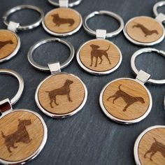 A handmade key ring with the dog of your choice etched into the wooden disc.This key ring has been carefully hand made for you in our Brighton studio. You can choose between 10 dog illustrations; German Sheppard, Jack Russell, Bull Terrier, Corgi,...