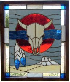 Stained Glass Southwestern Style Panel with a Cow Skull, Feathers and a Mesa in the background with a Oak Frame at Jitter Beans Mineral Wells, TX