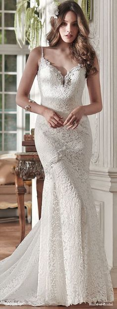 Modern femininity is found in this lace fit and flare wedding dress, with opalescent pearls dancing along the neckline, spaghetti straps, and deep V-back. Finished with covered buttons over zipper closure.