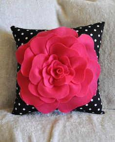 Pink black/white polka dot pillow... a lighter pink or red