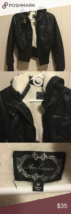 Faux leather shearling jacket This comfy and stylish faux leather bomber jacket is lined with soft faux shearling and has a hood. It's a must have for winter! Ambiance Apparel Jackets & Coats Utility Jackets