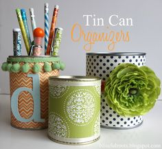 #DIY Tin Can Organizers simply cover old tin cans in colorful scrapbook cover with modge podge, adding ribbons and other decorations