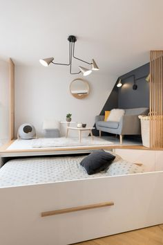 ingenious hideaway bed saves valuable space in this chic studio apartment - Living in a shoebox Studio Apartment Living, Apartment Interior, Studio Living, Apartment Layout, Studio Apartment Furniture, Studio Apartment Design, Apartment Checklist, Space Furniture, Living Room