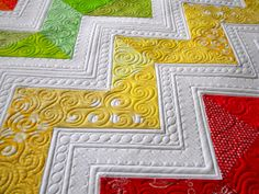 Sew Kind Of Wonderful: Lisa's Chevron Quilt. I love the quilting in each chevron.