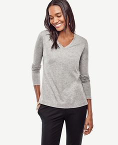 "In refined pima cotton, our soft V-neck tee is always flattering, versatile and layer-ready. V-neck. Long sleeves. Side slits. 26"" long."