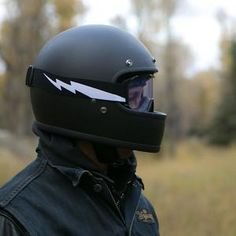 """This tragically hip yet mercifully under-styled DOT approved retro full face skid lid ditches trendy vents and gizmos to create a stripped-down aesthetic that screams """"high speed."""" Features include a seamless injection-molded ABS outer shell,..."""