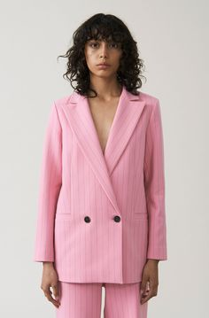 GANNI -Pinstripe blazer with feminine lapels and front pockets. Also available in black. I'm quite loving the pink though!