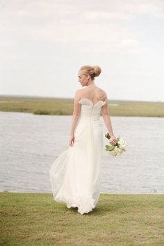 #Bride wearing a classic bun and a gorgeous flowing #dress