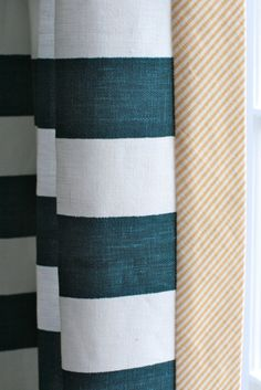 navy and white striped curtains with a contrast trim. would be cute for boys' room