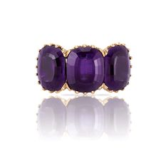 Two-Color Gold and Amethyst Ring. 18 kt., the rose & pierced white gold mounting applied with a finely engraved garland motif centering 3 cushion-shaped amethysts approximately 14.25 cts., signed Buccellati, Italy.