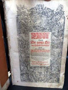 1613 Martin Luther German Bible with Wood Cover. The repair job is a must see. It's just different.
