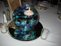 Blue orchid centrepiece with floating tea light