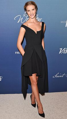 Rosie Huntington Whiteley in a sculptural black dress and heels