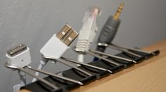 Keep cables from slipping off your desk with binder clips