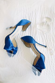 Blue Manolo Blahnik wedding shoes | @cocotranphoto | Brides.com #manoloblahnikwedding