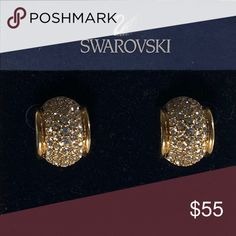 "💃💃 Swarovski Gold Tone Pierced Crystal This pair of Swarovski   Gold tone Rhodium plated Crystal pierced  earrings  radiate a Golden  glow and brings classic elegance.  No missing crystals- 1"" inch wide It is in good vintage condition . Very minor wear  Since 1989 ,including this earrings all genuine Swarovski products feature the swan logo .  1895  Swarovski makes extremely high and finest quality crystal in the world. It is well-known for their lines of sparkly , spotless,reflective…"