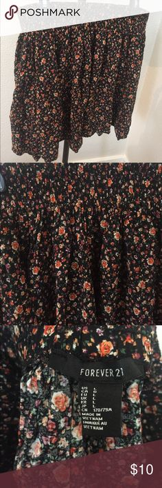 Patterned Skirt Cute flower patterned skirt! Looks cute with ankle boots! Hardly worn!! Forever 21 Skirts Mini