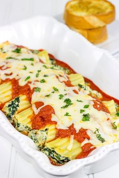 This Baked Manicotti with Spinach features a tasty ricotta filling...it's the perfect comfort food for a chilly late Fall night!