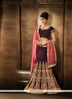 Aspiring to make a mark in the world of style, here is the attire to breath life into your aspirations. Stand out from rest with this wine fancy fabric and net a line lehenga choli. The embroidered, p...