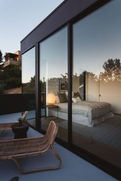 Tall floor-to-ceiling windows provide ample light to the master bedroom inside. #Windows