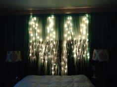 DIY Curtain & string lights behind headboard. on wall instead of windows.