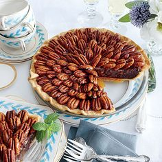 Salted Caramel-Chocolate Pecan Pie Recipe - A cross between a fudge pie and pecan pie, this is all the more stunning if you arrange the pecans from the center in a spiral pattern.
