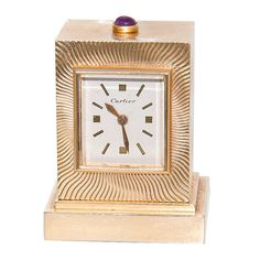 yellow gold and cabochon ruby miniature 8 day clock by cartier with geneve clock co movement usa