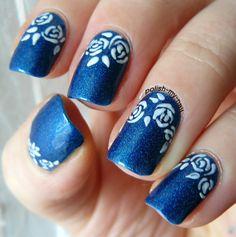 Fast roses on a blue holo polish. #nails #nailart #roses