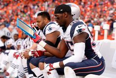 Chandler Jones #95 of the New England Patriots holds a Microsoft Surface tablet on the sideline in the third quarter against the Denver Broncos in the AFC Championship game at Sports Authority Field at Mile High on Jan. 24, 2016 in Denver, Colo.