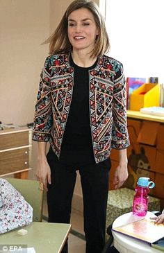 Letizia wore an embellished Zara jacket, which she previously stepped out in last November...