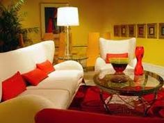 This is a very warm room. It uses hues of red, red orange, orange, and yellow. This makes it and analogous color scheme room.