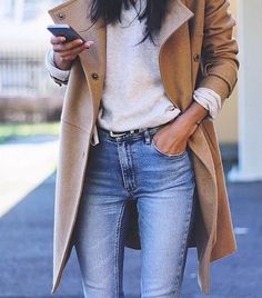 Fall trench coat, white tee, and jeans.